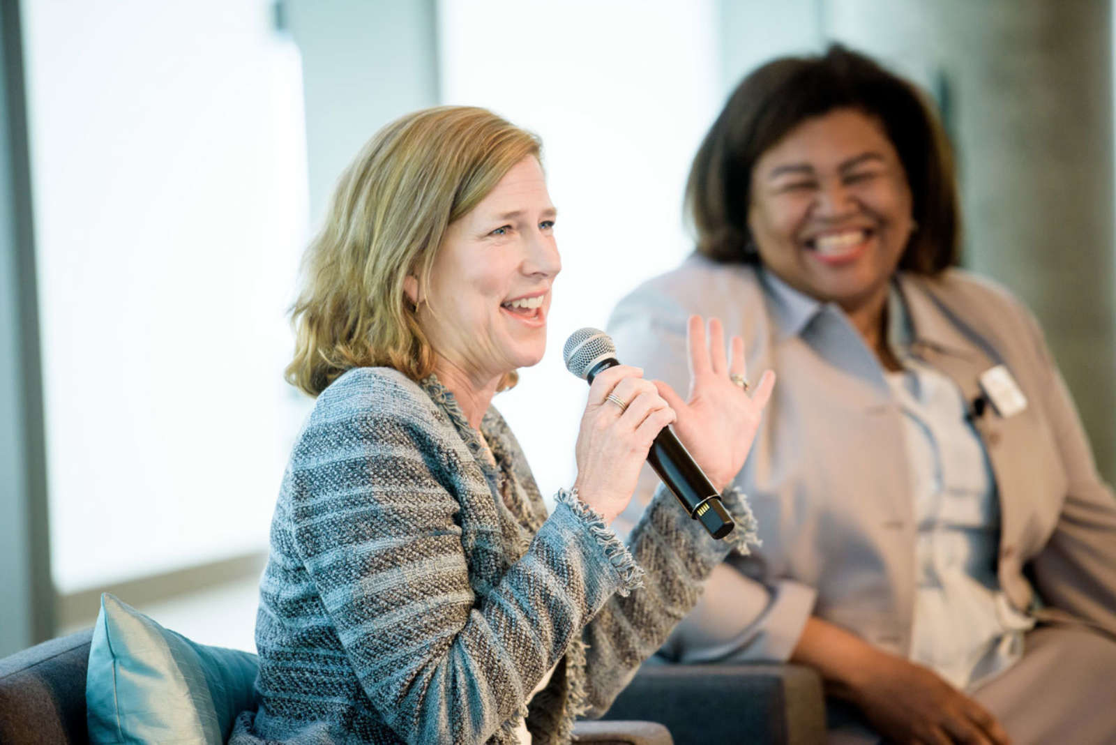 Conference Cheryl McGee Wallace and Sara Dickison Taylor fireside chat laughing