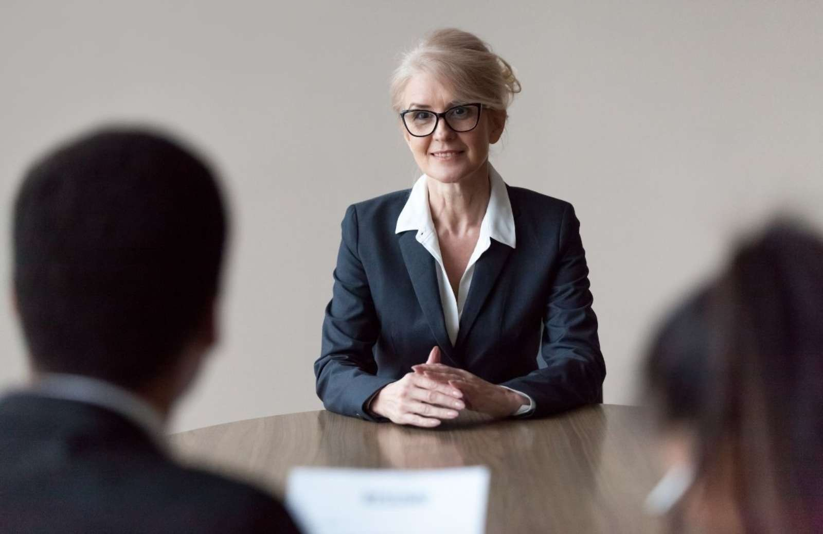 Smiling middle aged female job applicant making first impression at interview
