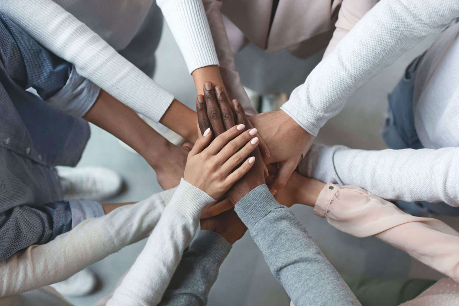 Business partners community team putting hands together on top of each other