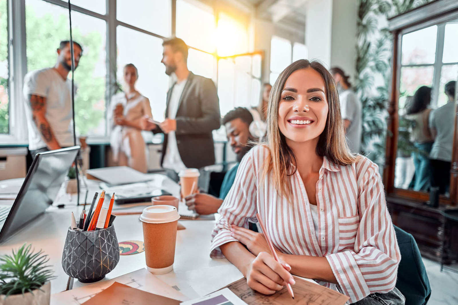 Confident woman sitting in coworking space office setting
