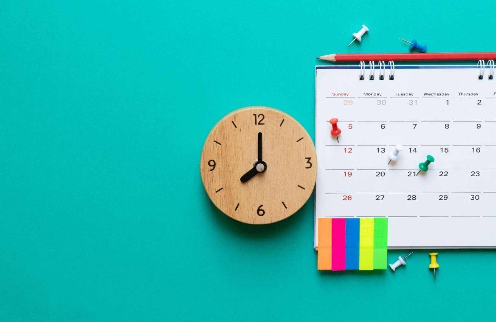 Clock, calendar, and post-it notes on a blue background
