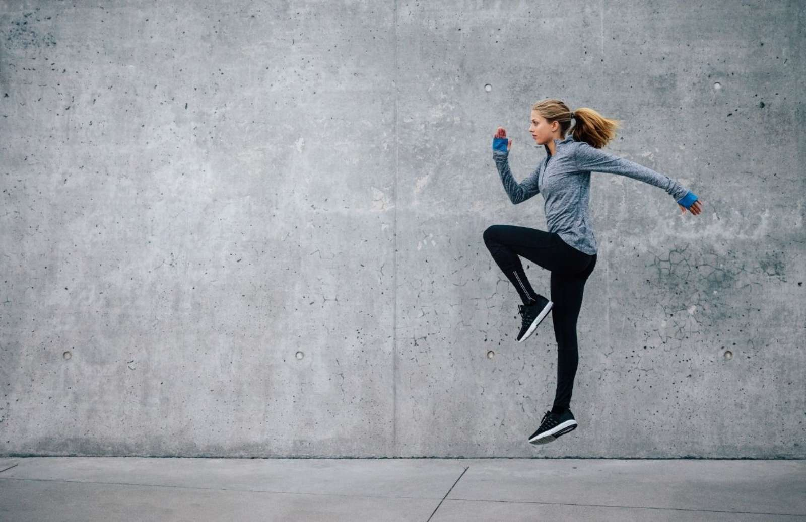 Woman jumping while exercising