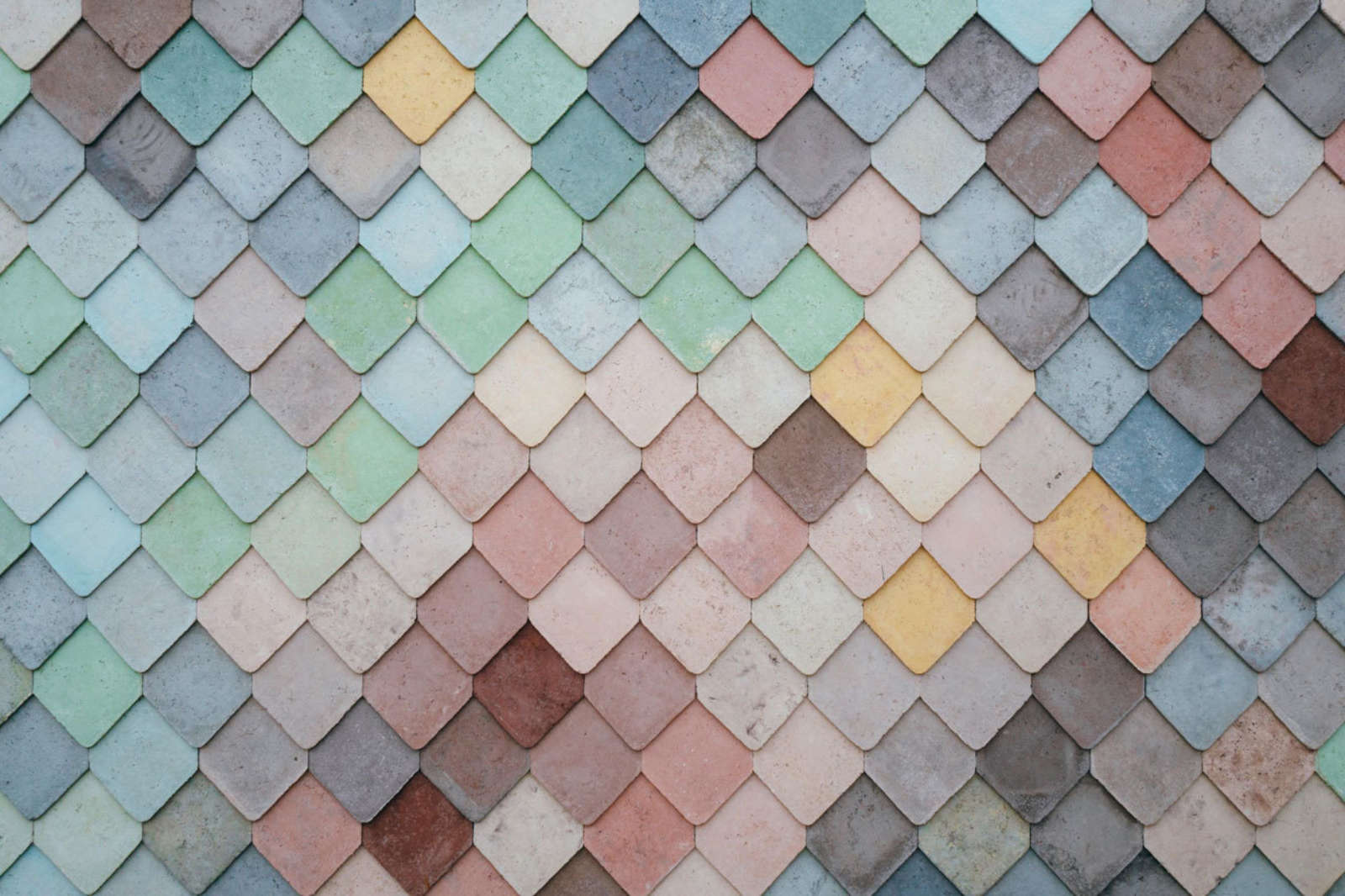 Multi color textured wall of mosaic tiles