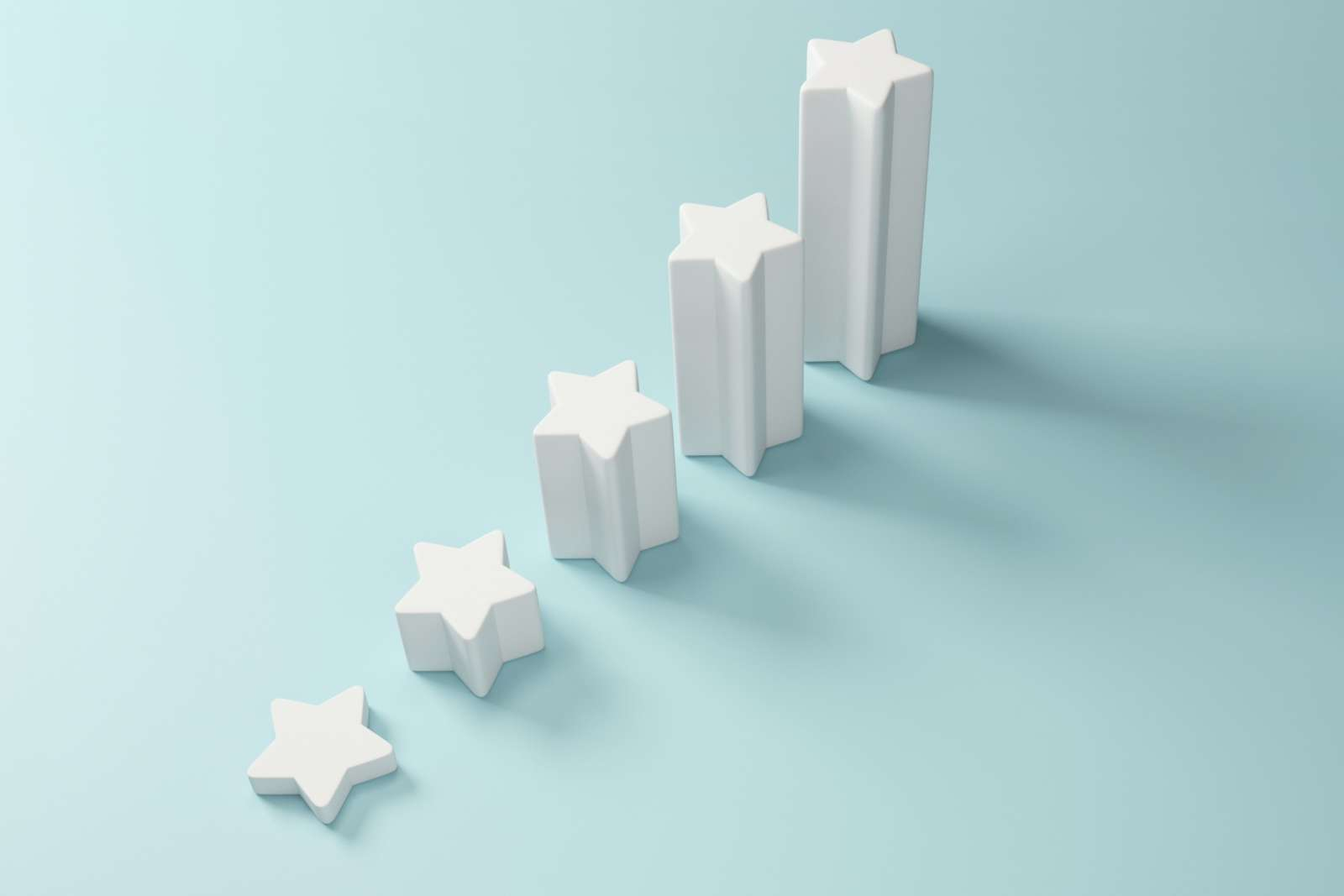 Five white three dimensional stars increase in height each a step above the one before it. The star steps are on a light blue backdrop.