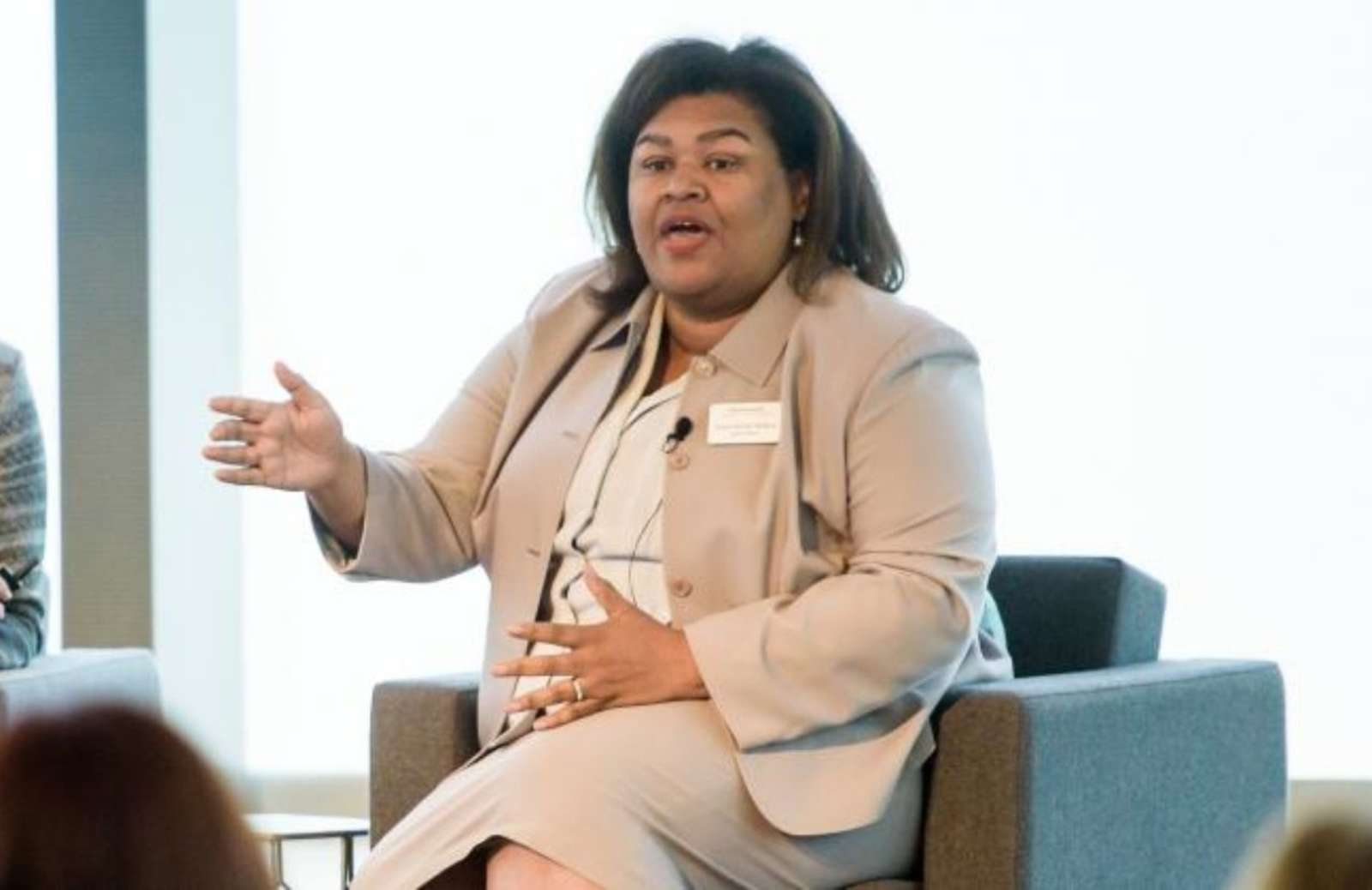 iRelaunch team member Cheryl McGee Wallace gesturing while speaking