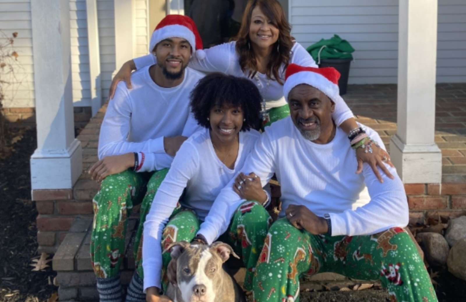 iRelaunch team member Janet Paterson sitting on front porch with family all wearing matching christmas clothes