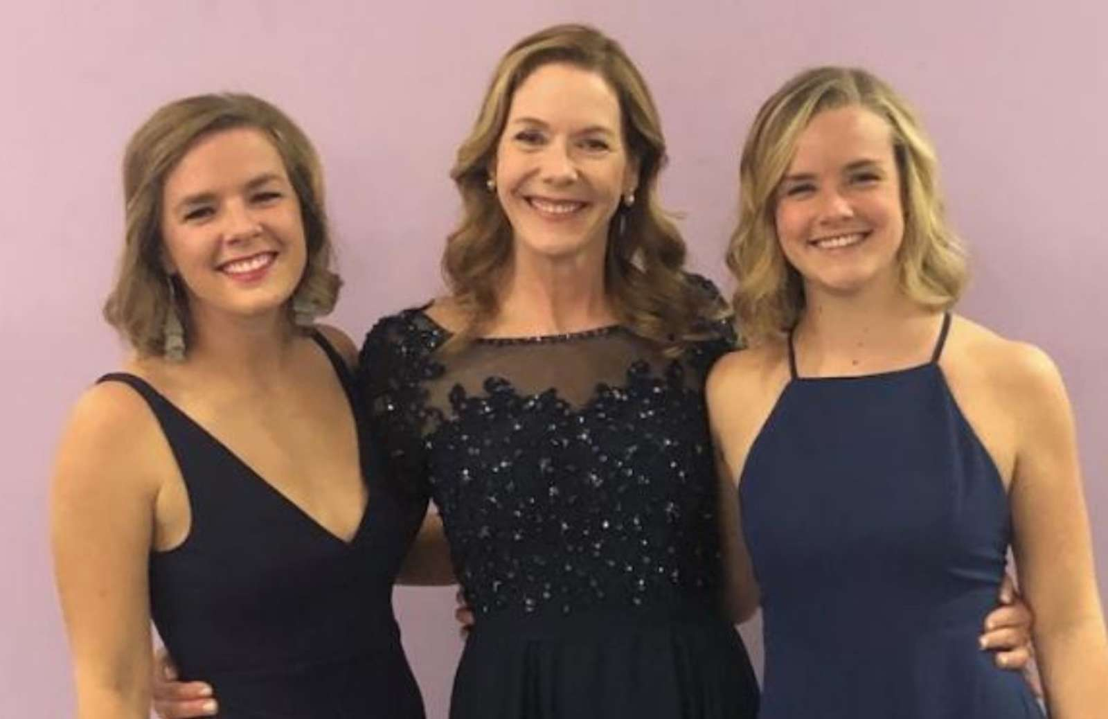 iRelaunch team member Jennifer Howland standing with two daughters