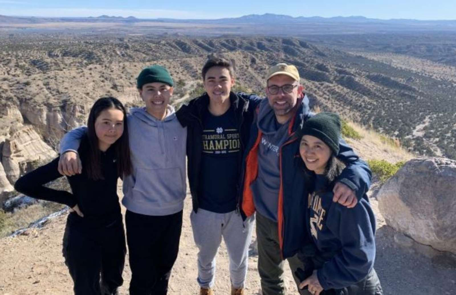 iRelaunch team member Mari Bailey standing with her husband, daugher, and two sons at the Grand Canyon
