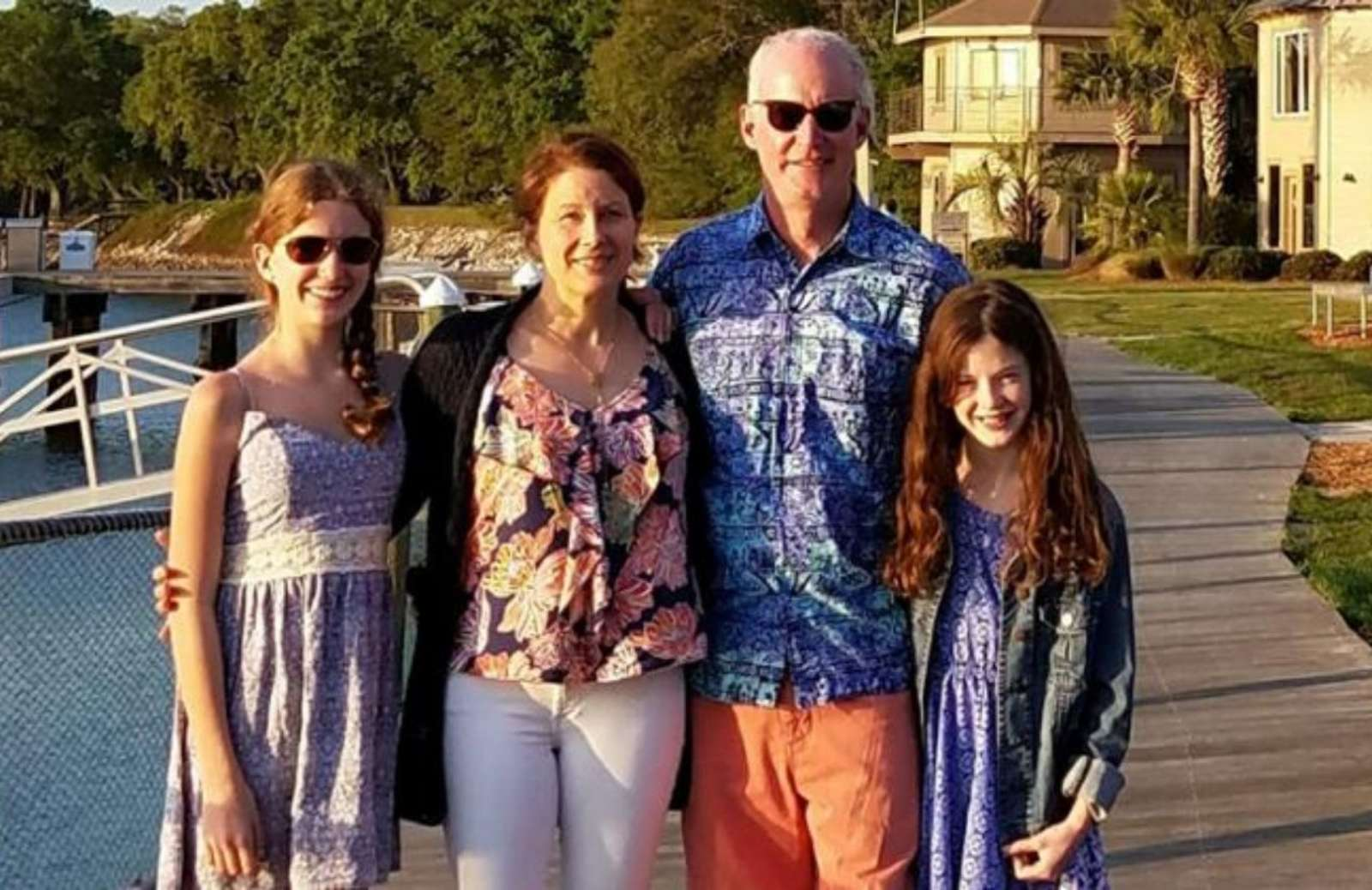 iRelaunch team member Sarah Mills standing with her husband and two daughters