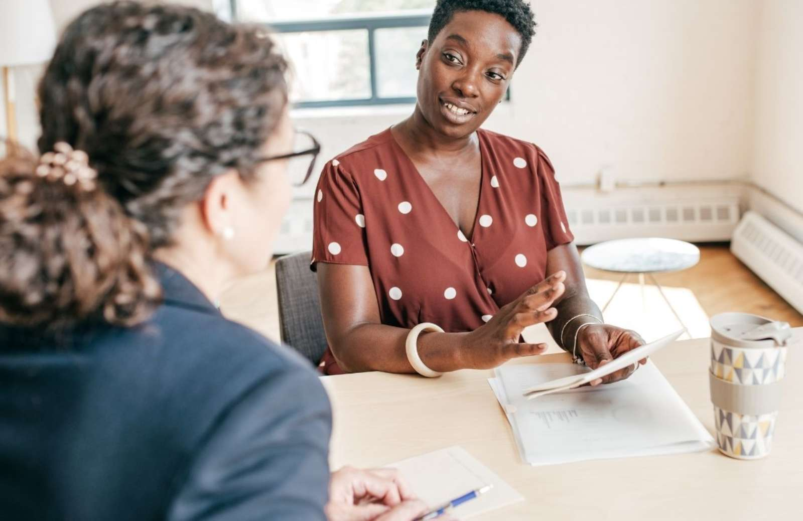 Two women at an interview in an office setting