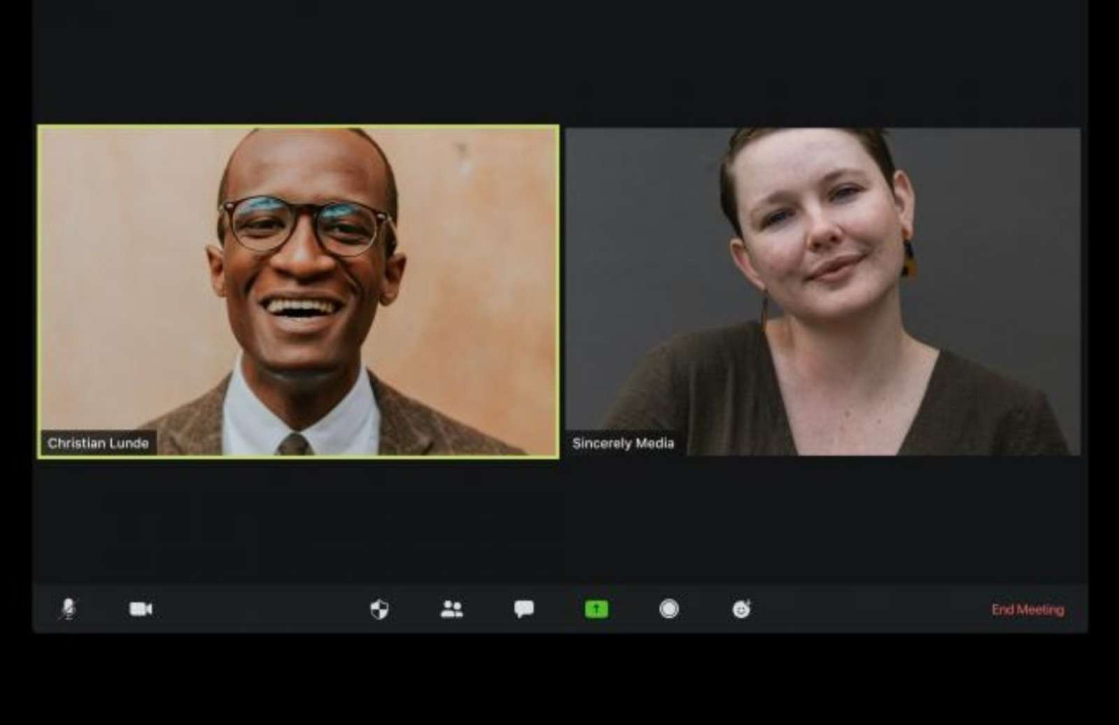 Professional man and woman in different virtual meeting windows on computer screen