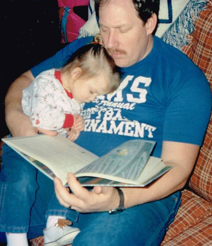 Shannon Amspacher's father reads to a sleeping Shannon as a toddler