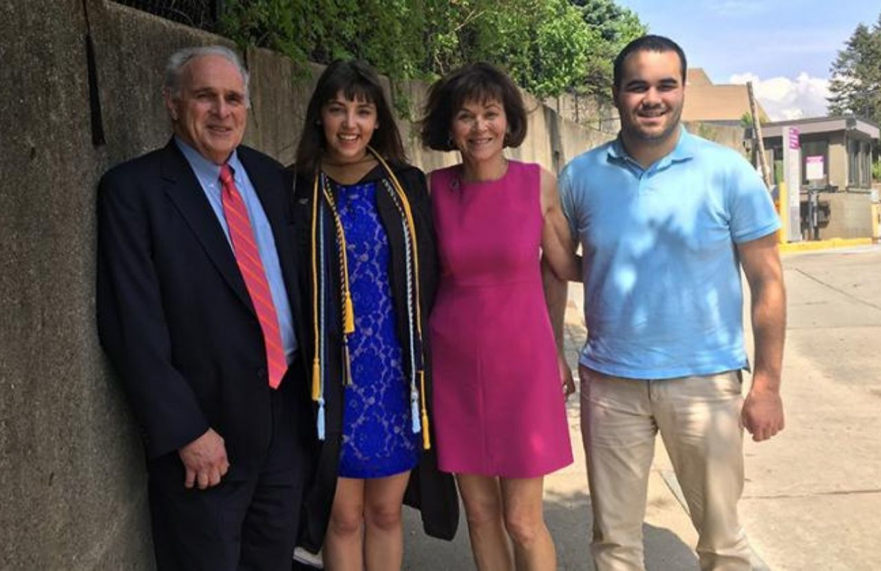 Anne Zacharias and her family smile at her daughter's graduation